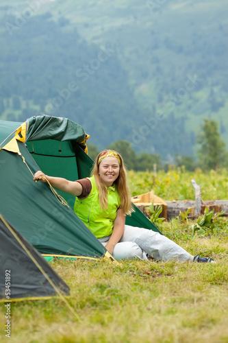 Happy  hiker in camp tent