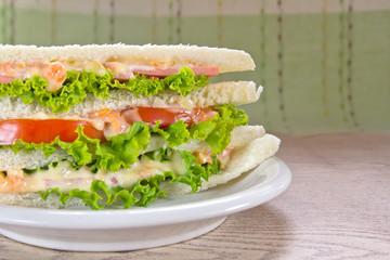 A ham salad sandwich on oat bread
