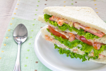 A ham salad sandwich on oat bread