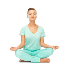 girl sitting in lotus position and meditating