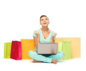 woman with laptop and shopping bags