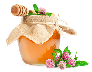 Sweet honey in a glass jar with clover