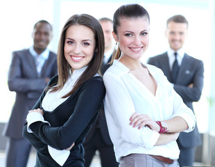 Two business women team at office building