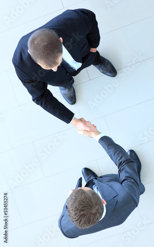 Top view of a two businessman shaking hands