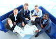 Top view of working business group sitting at corporate meeting