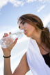 Woman drinking water after sport activities