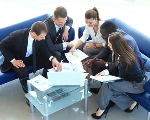 Top view of working business group sitting at meeting