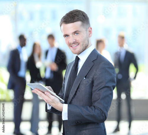 Business man touching digital tablet with business diagram
