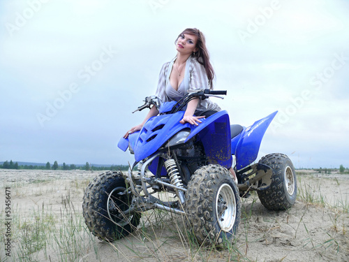 Beautiful girl on a quad bike.
