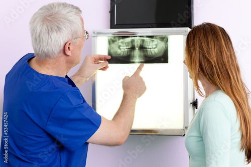 Dentist and patient discussing an x-ray.