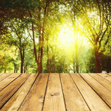 Fototapety Empty wooden deck table over forest background