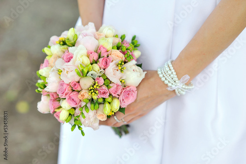 Bride holding wedding bouquet in hands