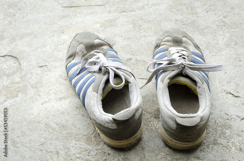 Old Running Shoes with concrete floor