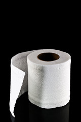 toilet paper isolated on black background