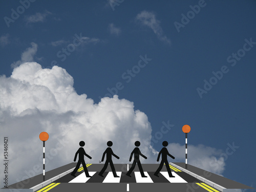 Four men on a zebra crossing
