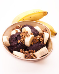 Acai bowl with bananas and granola