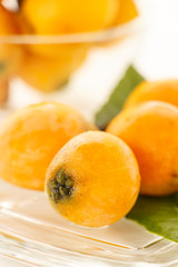 Loquat on the glass plate with white background