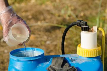 Adding pesticide