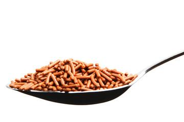Brown chocolate sprinkles in a spoon
