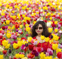 A beautiful woman in a tulip field