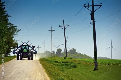 Farmer on Suburb Road - 53464845