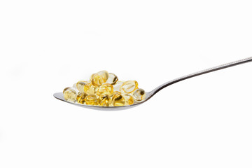 Vitamin in teaspoon, transparent yellow tablet with teaspoon
