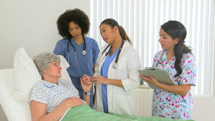 Caucasian patient receives news from her multiracial do