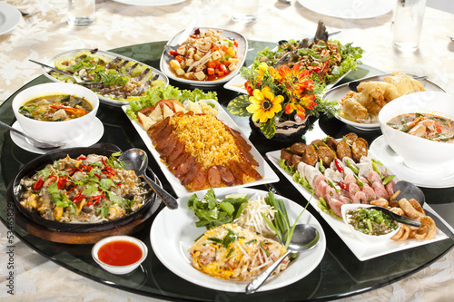 meal time, many kind of food dish put on round table