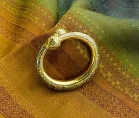Beautiful golden bracelet design in ancient Thai style
