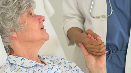 Close-up of Female African doctor holding her Caucasian patient'