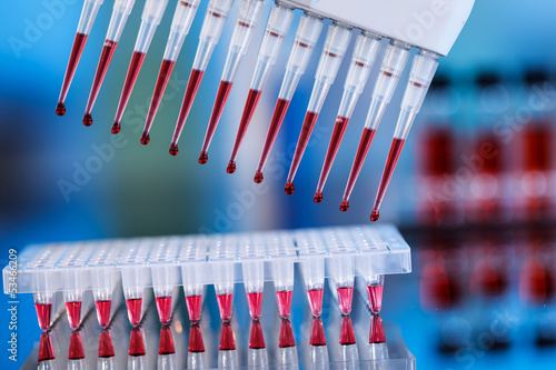 multipipette and sample tray biotech concept