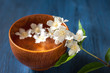 Spa. White flowers in a bowl of water on a blue board
