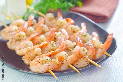 boiled shrimps are beaded on sticks