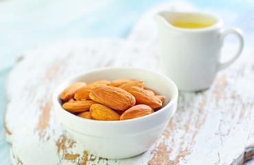 almond essential oil and almond in bowl