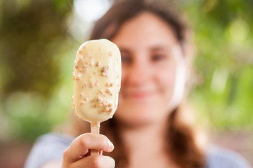 Girl holding a white chocolate ice-cream