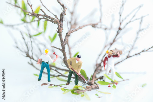 Miniature workmen doing logging works