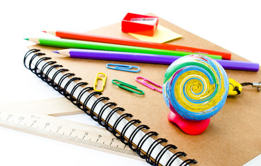 Back to school supplies with Notebook and pencil on white  backg