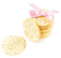 Sweet cookies tied with pink ribbon isolated on white background