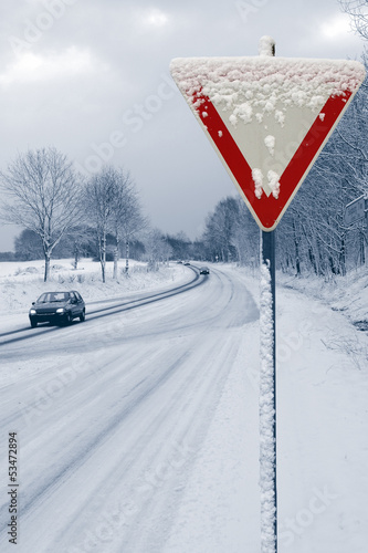 Onset of winter with road sign