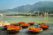 Puja flowers offering at the bank of Ganges river in Rishikesh,