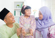 Southeast Asian Malay family saving money