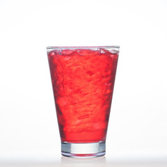 Sparkling red color drinks with water soda in glass isolated