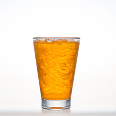 Orange flavor drinks with sparkling soda ice in glass isolated