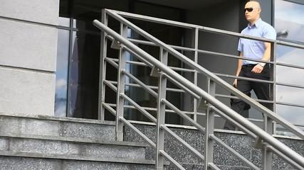 Businessman leaving an office center