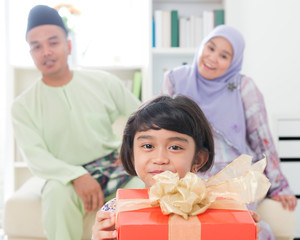 Southeast Asian girl with gift box
