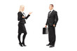 Full length portrait of a businessman and businesswoman talking