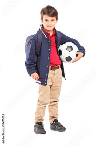 Full length portrait of a schoolboy holding a soccer ball