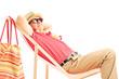 Mature male tourist enjoying on a beach chair