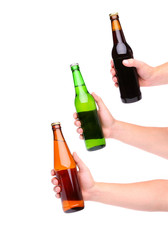 Three beer bottles and hands