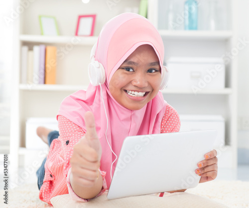Asian teen listening to music